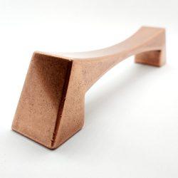CALEIDO fém bútorfogantyú , antik réz színű, 128 - 320 mm furattávval