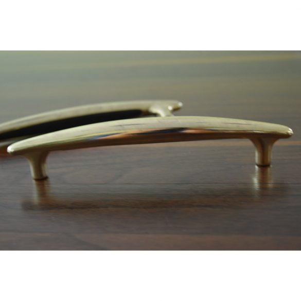 Fém bútorfogantyú, 128 mm furattávval, arany színben