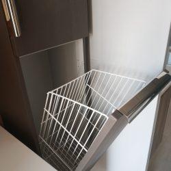 Tilting laundry basket