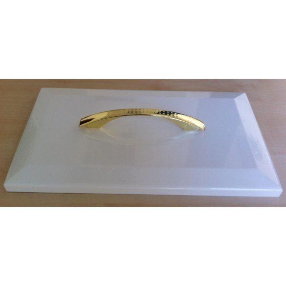 Shiny gold coloured metal furniture handle