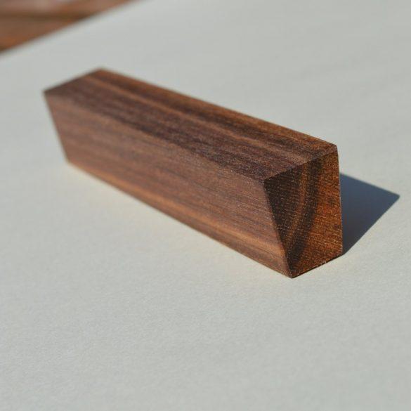 Solid wood, oiled walnut handle