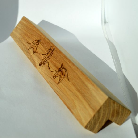 Engraved solid wood furniture handle. Drill spacing 128-160 mm oiled