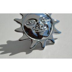 Metal furniture knob with silver sun motif