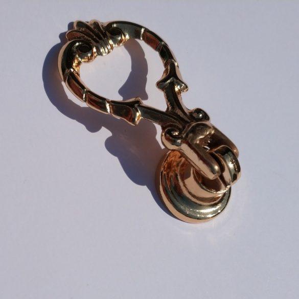 Classic gold coloured metal furniture knob