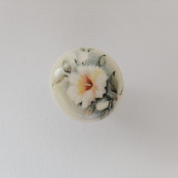 Ivory porcelain furniture knob decorated with a floral motif