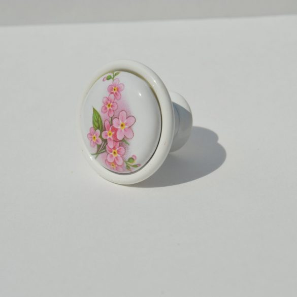 Porcelain knob in white with a pink flower motif