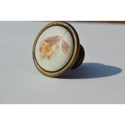 Porcelain furniture knob with brown flower motif in matte off-white colour